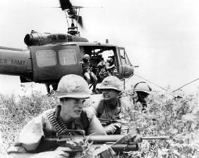 American soldiers exit a helicopter during Operation Oregon in the Vietnam War