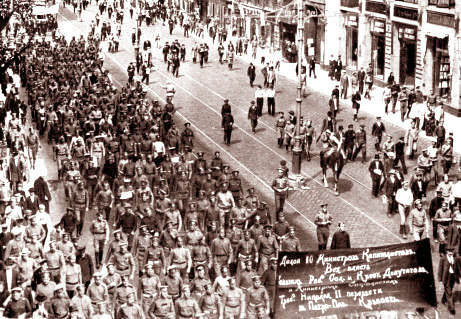 "Street demonstration, Petrograd, 18 June 1917. The banner in the foreground reads ""Down With The 10 Capitalist Ministers/ All Power To The Soviets Of Workers', Soldiers', And Peasants' Deputies/ And To The Socialist Ministers/ [We Demand That Nicholas II Be Transfered To The Peter-Paul Fortress."""