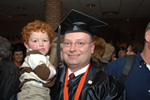 photograph of graduating student in gown and cap