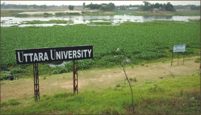 The authorities of Uttara University put up signboards on the floodplain of Turag river with a plan to set up their campus on the vast wetland