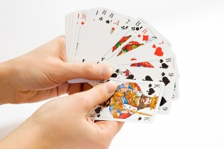 Hand of cards white background.jpg