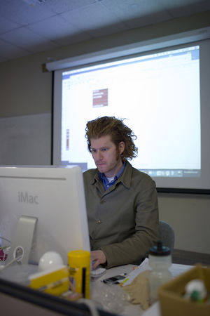 Teacher concentrating on computer screen.jpg